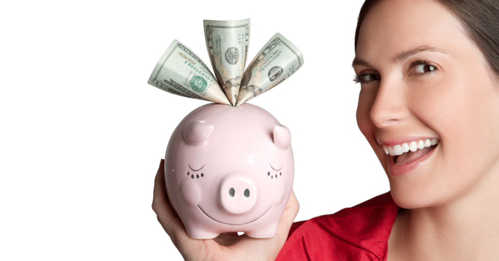 emergency savings accounts imagewoman holding a piggy bank with dollars sticking out