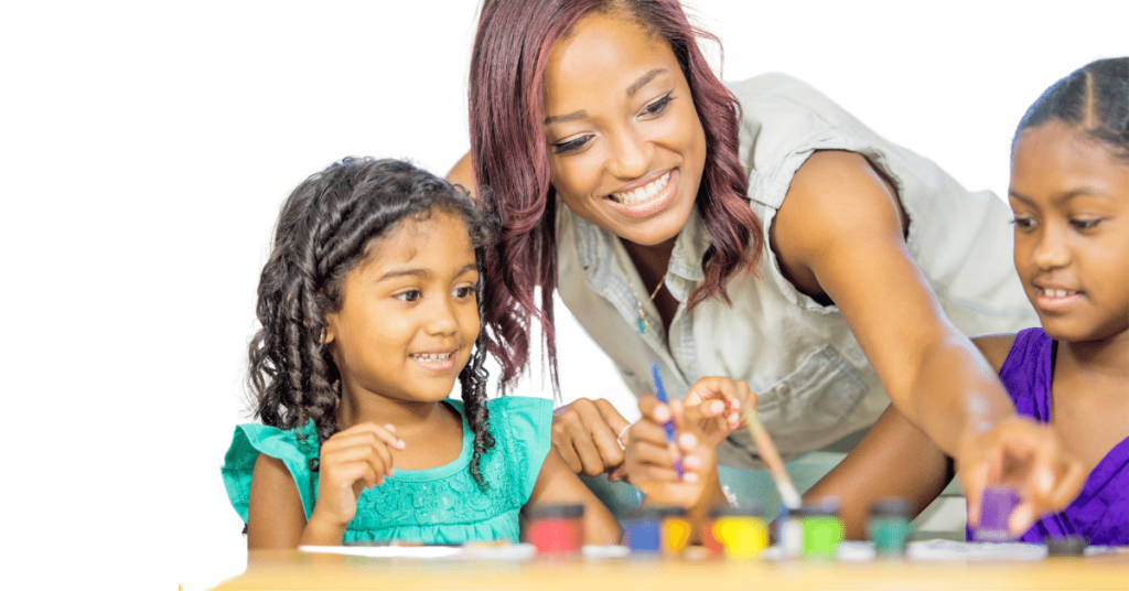 how do kids learn: a picture of a black mother painting with 2 small girls